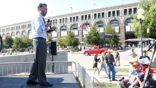 Republican challenger Dr. Christopher Peters campaigns for the 2nd House District at the Des Moines Register Soapbox during the Iowa State Fair Des Moines, Thursday, Aug. 11, 2016.