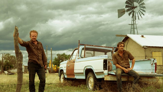 """Ben Foster (left) and Chris Pine play estranged brothers who come together to save their family's land by any means necessary, including bank robbery, in """"Hell or High Water."""""""