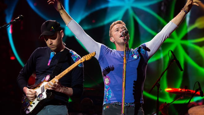 Jonny Buckland (left) and Chris Martin will lead Coldplay into the Rose Bowl this weekend.