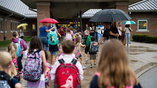 Students arrive for the first day of school at Locust Grove Elementary in Oldham County.