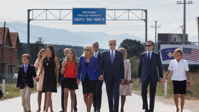 Biden family members lead by Vice President Joe Biden attend a ceremony outside Camp Bondsteel, Kosovo, on Wednesday to dedicate a highway in honor of late Delaware Attorney General Beau Biden, who died last year of brain cancer. The dedication was a sign of respect and gratitude for Beau Biden's contributions to Kosovo.