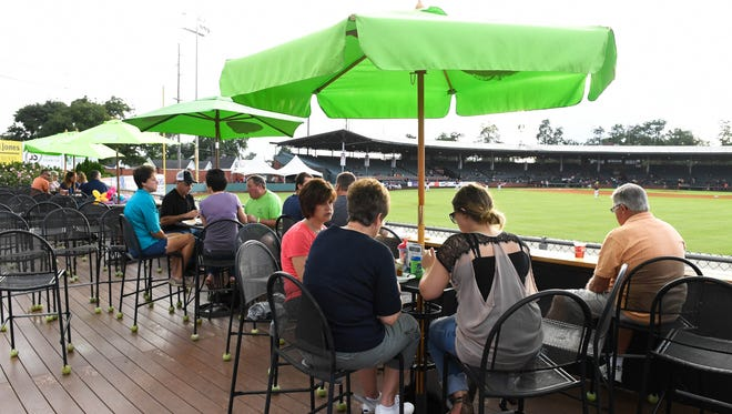 Otters fans enjoy a meal on the outfield deck before the start of Saturday's game with the Florence Freedom at Bosse Field, August 20, 2016.