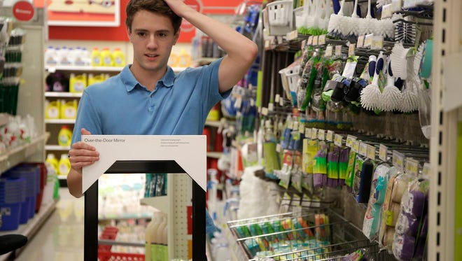 Drew Tippet, 19, and his mom, Laurie Tippet, shop for kitchen supplies for Drew's first apartment at the Lake Zurich Target store on Thursday, Aug. 11, 2016 in Lake Zurich, Ill. Tippet is going to be a sophomore at Indiana University where he studies business. He bought a mirror and sheet set from the dorm-themed areas of the store.   (Stacey Wescott/Chicago Tribune)