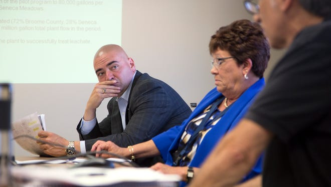 Sen. Fred Akshar listens as Paul Speranza of i3 Electronics outlines the company's method for treating landfill leachate during a meeting at the i3 treatment facility in Endicott on Wednesday , August 24, 2016. Local politicians met with i3 officials amid public concerns about how water is treated for metals and other hazardous materials at the plant.