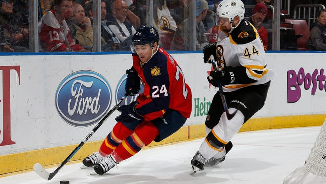 Ex-Wing Jiri Hudler, left, is checked by Boston's Dennis Seidenberg at the BB&T Center in Sunrise, Florida. Hudler signed a one-year deal with Dallas Wednesday.