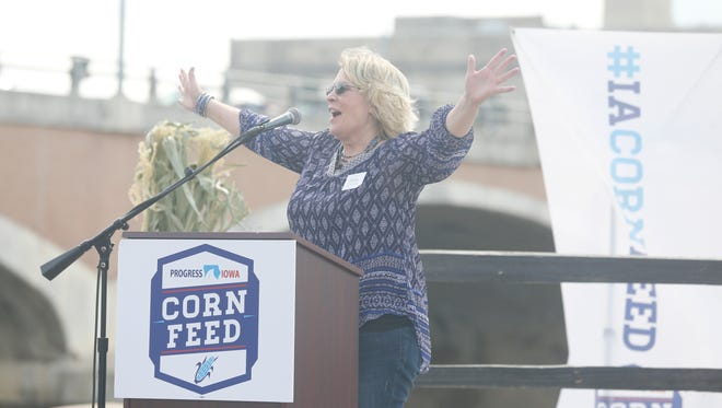 Fourth District Congressional candidate Kim Weaver greets the crowd at the Progress Iowa Corn Feed at Simon Estes Amphitheater in Des Moines, Sunday, Aug. 28, 2016.