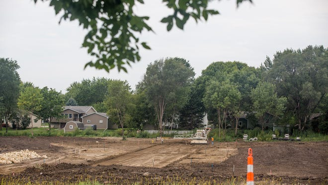 Workers clear trees from the Brandon's Reserve development, 1010 Warrior Lane, last year. M&R Holdings faces a $8,350 fine from the Environmental Protection Agency for allegedly discharging pollutants into a Waukee creek.