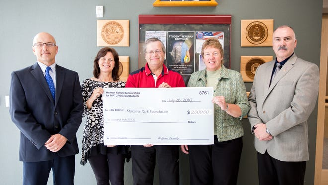 Tom Heffron recently presented Moraine Park Technical College with a scholarship donation to benefit its student veterans. Pictured here are, from left: Lt. Col. Scott Lieburn, U.S. Air Force, and dean of students at Moraine Park; Dana Knebel, director of college advancement; Heffron, presenting the check; Bonnie Baerwald, MPTC president; and Sgt. 1st Class Stephen Pepper, U.S. Army (Ret), as well as Moraine Park's student veteran specialist.
