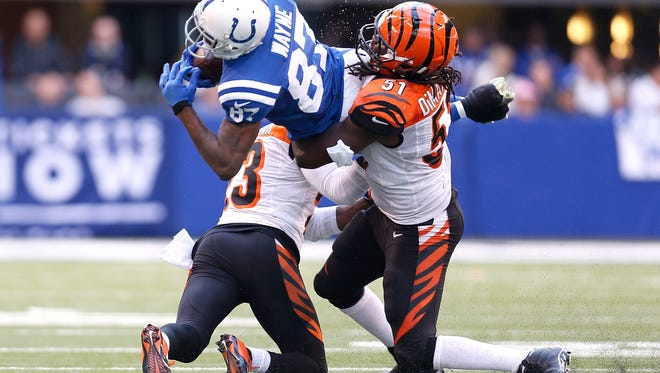 Bengals linebacker Jayson DiManche, right, tackles Reggie Wayne of the Colts at Lucas Oil Stadium in 2014.
