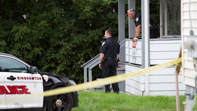 Police investigate the crime scene after two people were shot, one fatally, Aug. 31, 2016, at 1 Mozart St. in Binghamton.