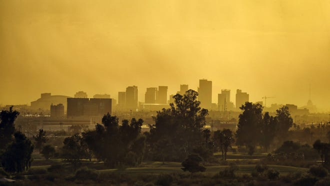 A dust cloud hangs over downtown Phoenix as the sun sets on Sept. 1, 2016.