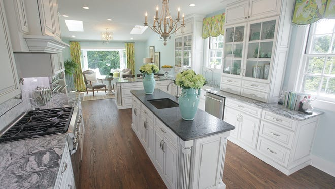 """The kitchen and hearth room by LL&A Interior Design at Designer's Show House """"The House on Village Drive"""" in Louisville."""