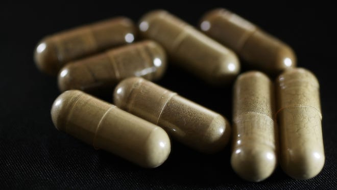 Capsules of the drug Kratom are seen on May 10, 2016 in Miami.