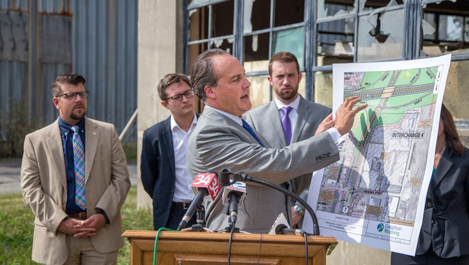 Jeff Hyman holds site plans for his company's proposal to redevelop the former Department of Transportation maintenance garage at 73 Frederick St. in Binghamton. The proposal included  a 250,000 square-foot retail center and a 120-room hotel. The project was unveiled during a press conference at the site on Sept. 8, 2016.