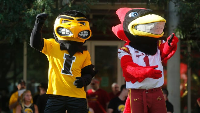 Herky and Cy applaud event organizers during the Rivalry Rally with a Heart at Western Gateway Park in Des Moines, Thursday, Sept. 8, 2016. The festivities included grilled food from Hy-Vee, live music, a food drive for the Food Bank of Iowa and more.