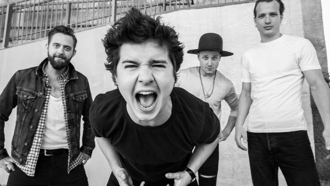 Lukas Graham, foreground, and his band.