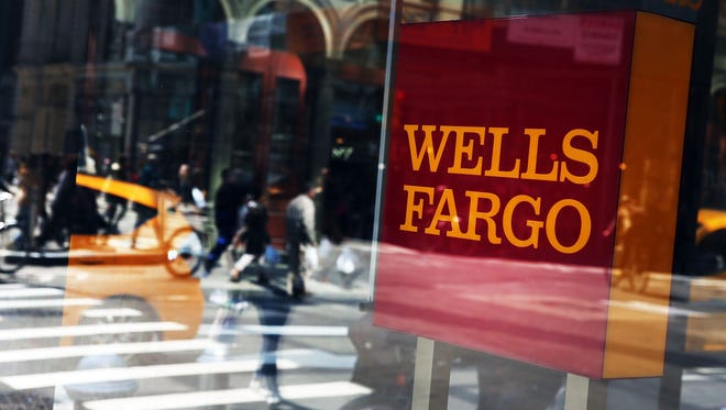 File photo taken in 2016 shows pedestrians passing a Wells Fargo bank branch in New York City.