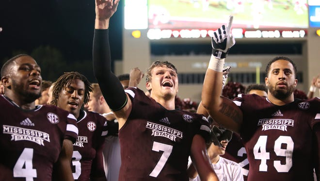 Mississippi State's Gerri Green (4), a 6-4 LB from Greenville, MS (Greenville Weston HS), Mississippi State's Traver Jung (3), a 6-3 LB from Greenville, MS (Holmes CC), Mississippi State's Nick Fitzgerald (7), a 6-5 QB from Richmond Hill, GA (Richmond Hill HS), and Mississippi State's Torrey Dale (49), a 6-6 DL from Kenner, LA (John Curtis Christian HS), celebrate following the win. Mississippi State played South Carolina in an SEC football game on Saturday, September 10, 2016 at Davis Wade Stadium in Starkville, MS. Photo by Keith Warren/For The Clarion-Ledger