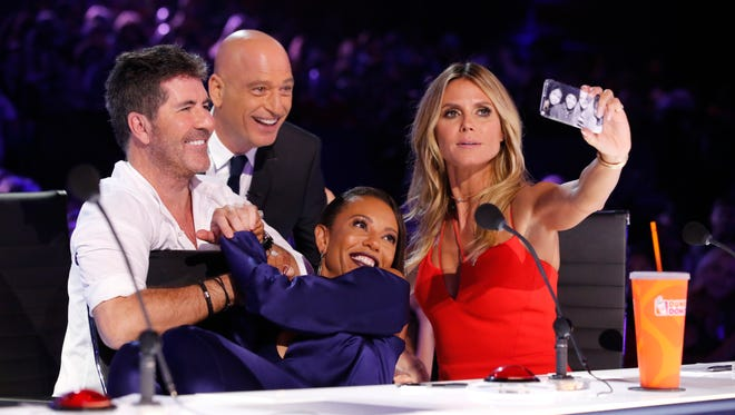Simon Cowell, left, joins fellow 'America's Got Talent' panelists Howie Mandel, Mel B and Heidi Klum during a taping of the NBC talent competition.