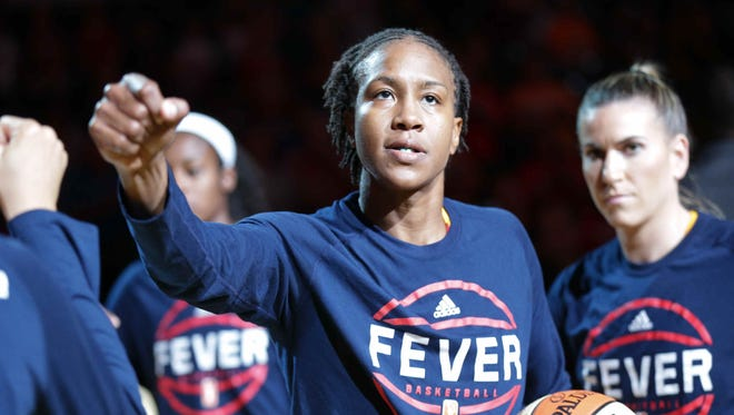 The Indiana Fever's Tamika Catchings fist bumps a team mate during starter introductions, Thursday September 1st, 2016. The Fever VS The New York Liberty at Bankers Life Fieldhouse.