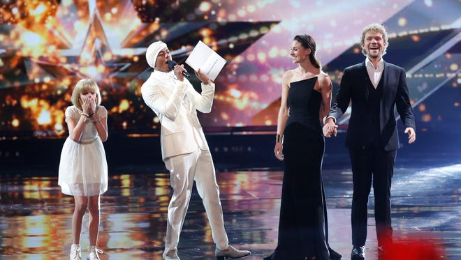 Grace VanderWaal, left, reacts as 'America's Got Talent' host Nick Cannon announces her victory, with The Clairvoyants finishing second.