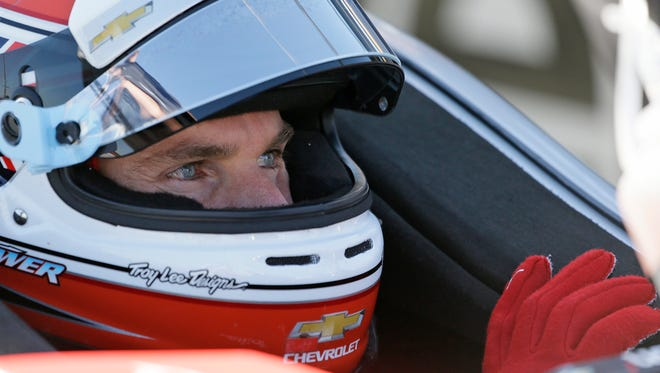 Will Power, of Australia, sits in his car during a warmup session before an IndyCar auto race Sunday, Sept. 18, 2016, in Sonoma, Calif. (AP Photo/Eric Risberg)