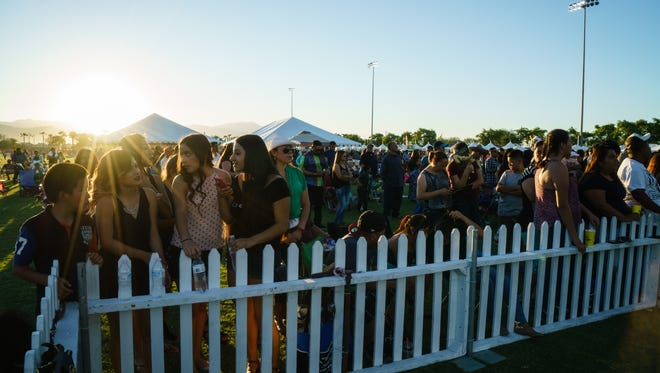 A large crowd waits for Erazno y la Chokolata to perform at El Grito celebration in Coachella, Sunday, Sept. 18, 2016.