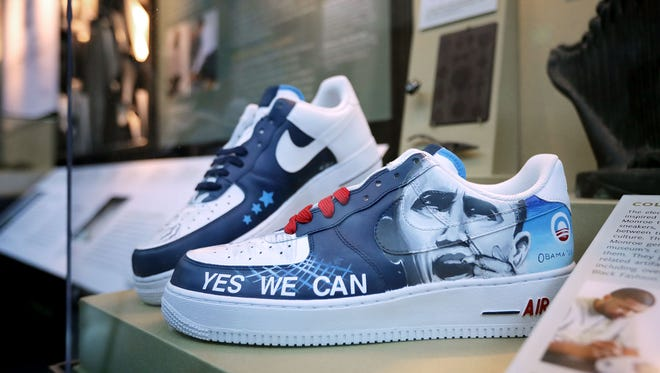 Sneakers with the hand-painted images of President Barack Obama by artist Van Taylor Monroe are on display at the Smithsonian's National Museum of African American History and Culture during the press preview on the National Mall September 14, 2016 in Washington, DC. Filled with exhibits and artifacts telling the story of the first Africans in the United States and their descendents, the 400,000-square-foot museum will open to the public on September 24.  (Photo by Chip Somodevilla/Getty Images)