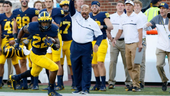 Michigan Wolverines RB Karan Higdon runs for a touchdown in the fourth quarter against Penn State on Saturday, Sept. 24, 2016 at Michigan Stadium.