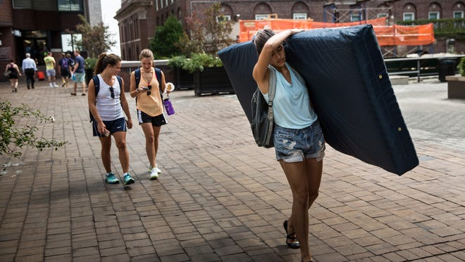 Emma Sulkowicz, a senior visual arts student at Columbia University, carries a mattress in 2014, in protest of the university's lack of action after she reported being raped during her sophomore year. The accused sued the school for gender discrimination.  Andrew Miltenberg is his lawyer.