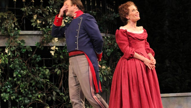 "David Daniel and Colleen Madden enjoy a moment during American Players Theatre's production of ""Much Ado About Nothing"" in 2014. That production is the subject of a new book by Michael Lenehan."