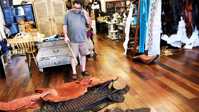 All American Gator Products owner Brian Wood works in his leather showroom in Hollywood, Fla. on Saturday, Sept. 10, 2016.