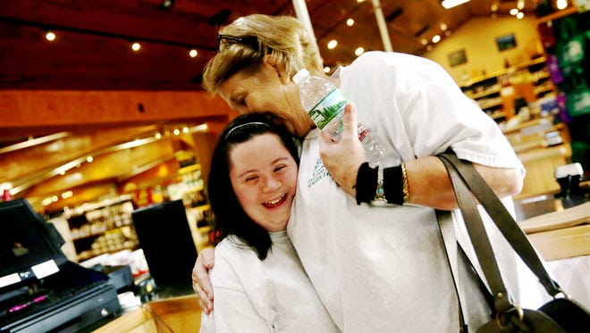 Cashier Sherry Phillips, right, hugs Caitlin Roggia, both of Naples, at Oakes Farms Market with Trailblazer Academy through the Foundation for the Developmentally Disabled in Naples on Thursday, Oct. 6, 2016. The Trailblazer Academy is a program designed to give adults with intellectual and developmental disabilities vocational training to help gain independence.