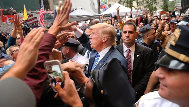 Donald Trump greets supporters outside of Trump Tower in Manhattan on Oct. 8, 2016.