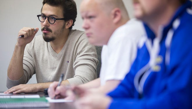 Graceland University student Ali Tokatli, a Syrian refugee, listens to a lecture in his capstone business class in Lamoni, Tuesday, Oct. 4, 2016. Tokatli, who fled Syria to Egypt on his own as a teenager, is graduating this December triple majors in Business Administration, Economics and Political Science with a concentration in Peace Studies.
