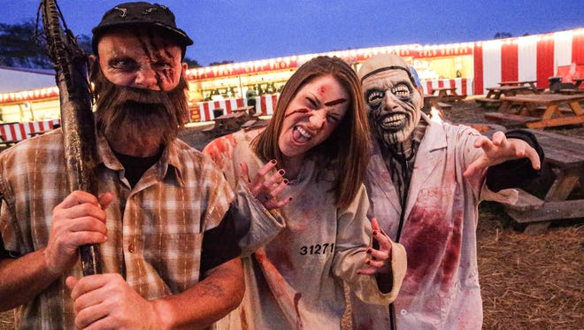 "Left to right, Dressed to scare, Indy Scream Park's Michael Armes, left, Indianapolis Star Reporter Amy Bartner, center, and Taylor Anderson, right, pose for a photo at Indy Scream Park's ""Brickmore Asylum"", Monday October 10th, 2016. Indianapolis Star Reporter Amy Bartner gets the full Scram Park employee treatment for a night, including a chance to scare patrons."
