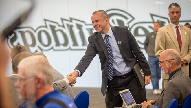 Newly announced Drake Relays Director Blake Boldon shakes hands with supporters at the Courtside Club of the Shivers Basketball Practice Facility in Des Moines, Wednesday, Oct. 12, 2016.
