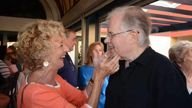 Judy Kenney gives a kiss to Don Farmer during a 2016 farewell party for Farmer and Chris Curle, who left Marco Island for Bentley Village in North Naples, where he died March 31, 2021.