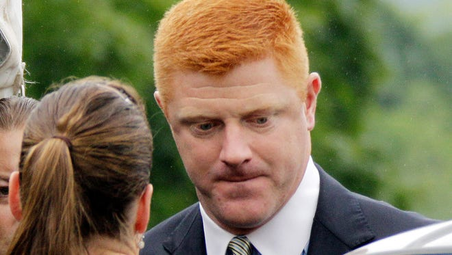 In this June 12, 2012, file photo, former Penn State University assistant football coach Mike McQueary arrives at the Centre County Courthouse in Bellefonte, Pa. McQueary's defamation and whistleblower lawsuit against Penn State over how it treated him for complaining about assistant football coach Jerry Sandusky sexually abusing a boy in a team shower is scheduled to go to trial Monday, Oct. 17, 2016, with opening statements in a courthouse near the university campus.
