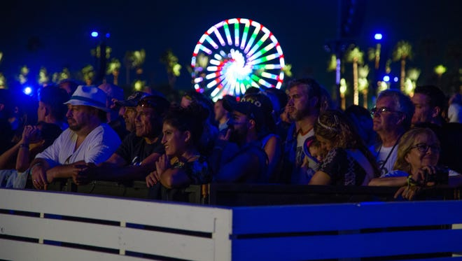 The crowd listens to Paul McCartney perform on the second weekend of Desert Trip, Saturday, October 15, 2016.