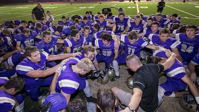 Notre Dame Prep prays following the high school football game between Paradise Valley and Notre Dame Prep at Notre Dame Prep on Thursday, October 6, 2016 in Scottsdale, Arizona. Notre Dame Prep won with a final score of 76-35.