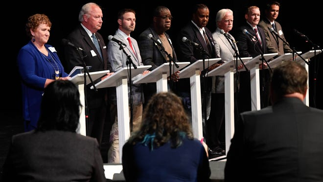 """Henderson City Commission candidates (L-R) Patti Bugg, Thomas """"Tom"""" Davis, Jesse Johnston IV, Kenny Perkins, Robert Pruitt, X.R. Royster, Bradley Staton and Austin Vowels during the Kyndle sponsored candidate forum held at the Henderson Fine Arts Center Tuesday, October 18, 2016."""