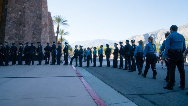 """Officers from the Indio Police Department arrive at the Palm Springs Convention Center for the memorial service for Officers Lesley Zerebny and Jose """"Gil"""" Vega."""