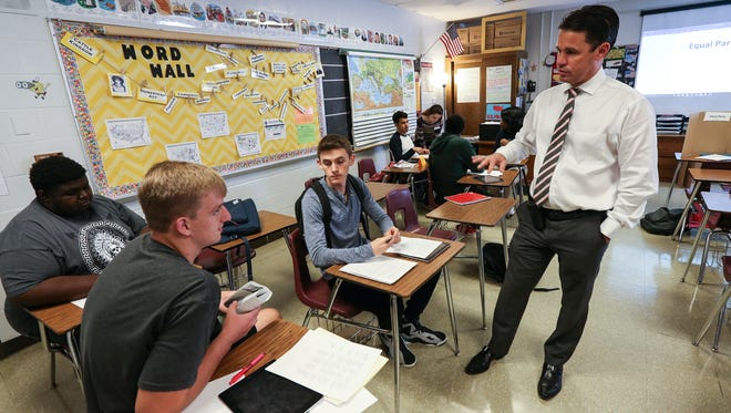 Doss Principal Marty Pollio talks with Darius Maddox, Mitchell Burba and Corey White in a history class at Doss High School.October 19, 2016