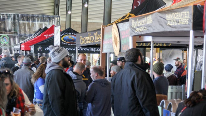 Over 700 Michigan-made beers drew thousands of craft beer aficionados to Eastern Market in Detroit during the 2016 Detroit Fall Beer Festival.