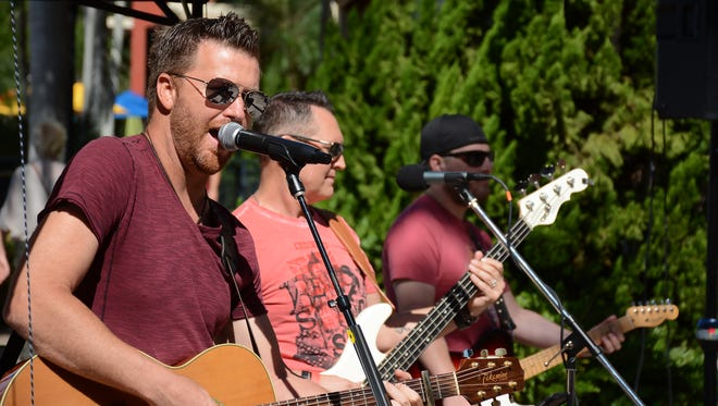 Ben Allen, left, sings with his namesake band. The Marco Island Fire-Rescue Foundation hosted the 4th annual Jerry Adams Chili Cook Off at the Esplanade Saturday afternoon, with 600 people sampling chili from 17 different chefs and organizations.