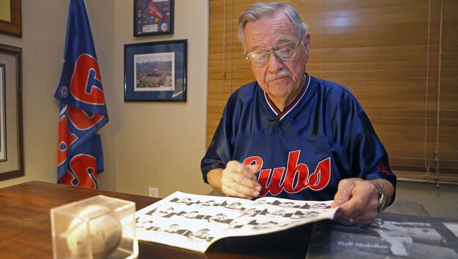 Herman Blote looks over some of his Chicago Cubs memorabilia from his visit to the 1945 World Series Monday, Oct. 24, 2016 at his home in Mesa. Blote watched the Cubs play in the World Series at Wrigley Field in 1945 when he was 10-years-old, and now, 71 years later, he is going to the game on Friday night.