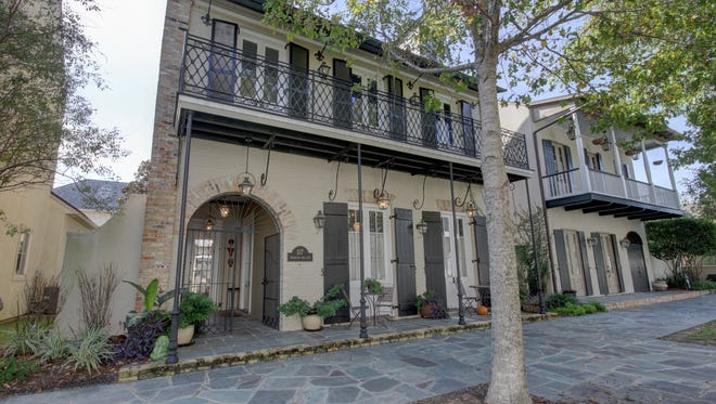 This classic French/New Orleans design home is located at 117 Princeton Woods Loop. It has 4 bedrooms and 41/2 baths and is listed at $832,218.