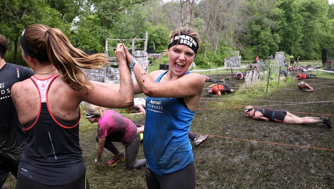 Celebrities Minka Kelly and Aimee Teegarden participate in a Spartan Race in Illinois in June.