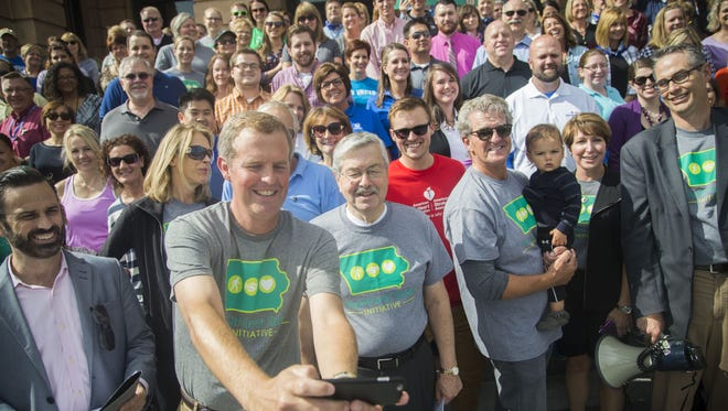 Delta Dental President Jeff Russell takes a selfie with then-Gov. Terry Branstad and a large group of walkers after the Healthiest State Initiative's walk from the Iowa Capitol to the World Food Prize Hall of Laureates Oct. 5, 2016, in Des Moines.